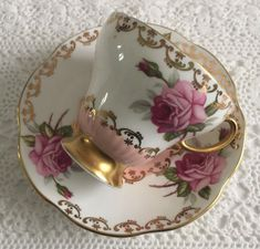 Vintage E.B Foley china tea cup and saucer, made in England. A beautiful duo in pink with pink roses and lots of gold gilding on both the cup and saucer. It is in good condition, both pieces ring nicely. There are no chips, cracks, crazing or repairs. Please Note: The items I sell