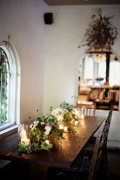 long rustic dining table, arch top window