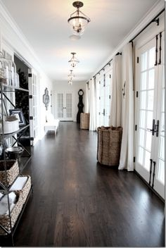This is exactly what I want to do with the hallways! Hardwood floors, clean lines, and curtains that soften the look as well as practical can be drawn for privacy and reduce heat. (using blackout curtains)
