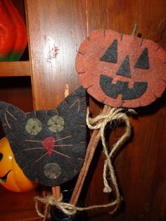 Felt Halloween Favors ~ love the stakes made out of cinnamon sticks.