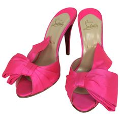 Christian Louboutin hot pink silk huge bow front high heel mules 40M | From a collection of rare vintage shoes at https://www.1stdibs.com/fashion/accessories/shoes/