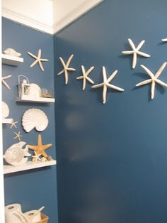 Beach themed half bath downstairs. A little over done, but I like the idea of it.