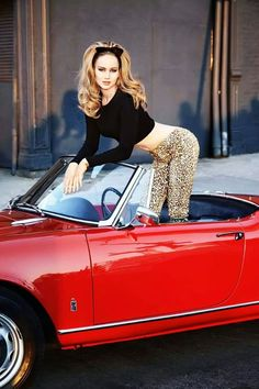 Jennifer Lawrence curves in a crop top and leopards print tight pants in a convertible