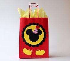 Mickey Mouse Favor Bags for any Mickey Mouse Party! Im so happy that I created this design, its so cute, bright and unusual. Very happy with how it turned out :) This listing is for favor bags with or without tissue paper, a digit on the bag is customizable. You can choose quantity, with or without tissue paper in the right corner under the price in Style. All options are described below. I decorate bags with premium quality cardstock cutouts. Bags are one-sided. Tissue paper may vary but…