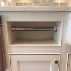 Okay so one of the things on my dream list for our kitchen was a built in paper towel holder because I hate counter clutter and yes that's dirt in there, we still have construction mess going on