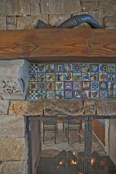 Custom tiles above fireplace #montana #luxury #bozeman http://bozemanluxuryrealestate.com/listings/an-estate-beyond-compare/
