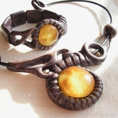 Hand-carved jewelery with genuine lemon baltic amber and beech wood. Love it!