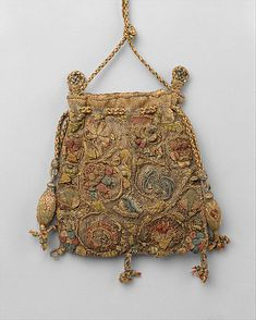Purse Date: last quarter 16th century Culture: British Medium: silk, gold, silver, linen Dimensions: Height (of body of purse): 5 1/2 in. (14 cm) Accession Number: 1986.300.1 The Metropolitan Museum of Art