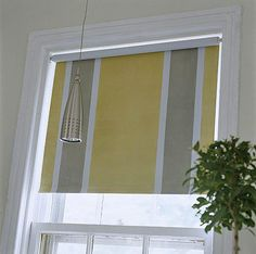 painted roller shade.  doing this to the craftroom shades as soon as I can.