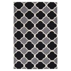 """Anchor your living room seating group or define space in the den with this artfully hand-woven wool rug, showcasing a quatrefoil motif for a pop of pattern.  Product: RugConstruction Material: WoolColor: Jet black and grayFeatures:  Hand-wovenMade in India  Pile Height: 0.157""""   Note: Please be aware that actual colors may vary from those shown on your screen. Accent rugs may also not show the entire pattern that the corresponding area rugs have."""