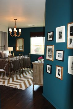 teal walls, love for the living room.  also loving the dark wood floors!