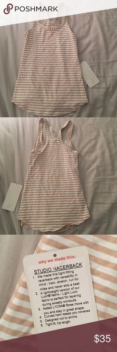Lululemon Studio Racerback NWT. Size 4.    • no trades • offers welcome • bundles! •                    • email on my about • • all lulu purchases ship in a small lulu bag • lululemon athletica Tops Tank Tops
