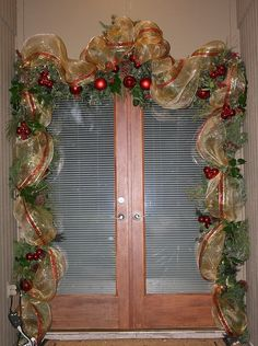 Front Door Garland using Deco Mesh and wired ribbon and tucking in some fresh greenery by sylharden Christmas Front Doors, Christmas Door Decorations, Christmas Swags, Diy Christmas Ornaments, Outdoor Christmas, Holiday Wreaths, Holiday Crafts, Christmas Holidays, Burlap Christmas
