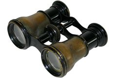 Antique brass opera glasses marked Paris, Le Marie on one side and Roth & Son, Los Angeles on the other.