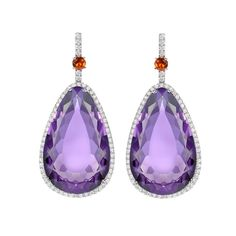 Stunning show-stopping pear drop amethysts surrounded by diamonds in 18ct white gold set with a vivid fire opal. Completely unique and one of a kind.