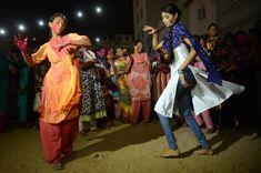 Pakistani Hindu women dance during Holi celebrations in Karachi on March 26, 2013. (Asif HassanAFP/Getty Images) #