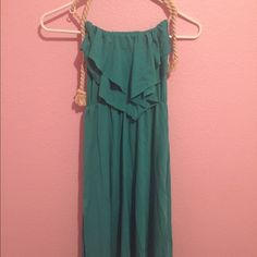 Blue/Green Sun Dress Teal-ish stretchy dess. Top ties. Very flowy and good for the summer. Goes a little past the knees. Open back. Dresses Midi