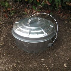 DIY Food Scrap Digester/Composter - you can spray paint the lid flat black to help draw heat and keep it more hidden