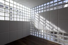 """ToLioRe is a minimal home located in Tokyo, Japan, designed by Atelier Tekuto. These three materials bring a balance to its structure. Compressive strength of glass blocks and ALC panels are almost equal, so these two can be replaced each other and provides unlimited wall patterns of solid and translucent wall. We believe that this system is a completed answer for Le Corbusier`s """"Free Façade"""". If you got money, the wall pattern can be change tomorrow. (14)"""