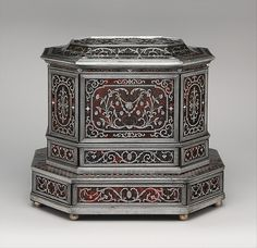 Wig cabinet (cabinet de coiffure),      ca. 1685, German, Künzelzau, Oak and walnut veneered with ebony, ebonized wood, and marquetry of pewter and mather-of-pearl on horn over paint, simulating tortoiseshell; silver; brocaded damask (not original)