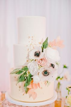 Blush Three-Tiered Cake With Anemones | Onelove Photography https://www.theknot.com/marketplace/onelove-photography-danville-ca-223204 | Chic2Chic Weddings