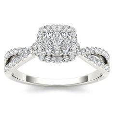 On the day you ask for her hand, wow her with this stunning engagement ring fashioned in white gold. Featuring a cluster of diamonds at the center, it is surrounded by a frame of smaller accent diamonds atop a diamond-lined criss-cross shank.