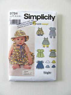 Sewing Pattern Simplicity 9784 Baby Girl Dress Pinafore Sunhat Pantaloons. $4.00, via Etsy.