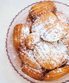 """Light and fluffy on the inside and crisp on the outside, Classic French Madeleines are completely irresistible. And they're easier to make than you might think! Just make the cookie batter, pour into a prepared tin, and bake! You're only a half hour away from having a batch of sweet, lemony madeleines. They're the perfect afternoon sweet treat, and they are sure to """"wow"""" your friends and family."""