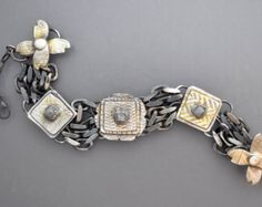 A beautiful sterling silver bracelet with a center piece of American white buffalo turquoise with wonderful domed silver amulet elements. Magical !! Please