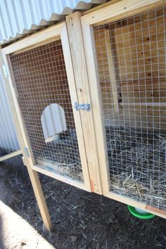 homemade hen house hinged doors with pull-out floor to clean easily... Great idea!