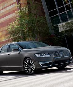 "Lincoln debuted the sleek new MKZ luxury sedan at an event in a former bathhouse in New York's East Village. The new model embodies ""quiet luxury"" and aims to appeal to a younger generation of drivers."