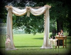 Draped Wedding Arbor | Arbor built from pallets, draped with burlap and tulle. Unity candle ...