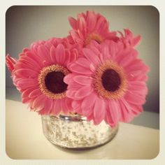 Turn your empty candle jars into adorable vases!