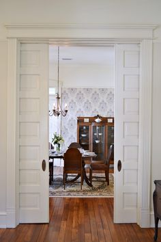 make a pocket door like this and put photographs over glass panes