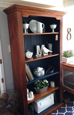 Timber bookcase painted in denim blue chalk paint.