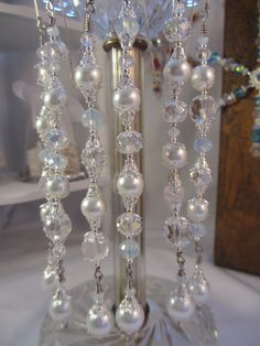 Beautiful white glass pearls and extra sparkly cut crystals with glowing silver plated bead caps and spacers. I love the simple elegance of these pearl sets.    There are 6 beautiful dangles in this set. Remember...They are not just for Christmas. They make fantastic lighting accents. This set measures about 5 inches. Hangers are included.    All of my dangles and snowflakes are made with glass and crystal beads by hand by me....I use Gold and silver plated bead caps as well as vintage beads…