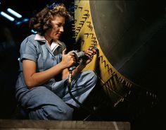 October 1942. Riveter at work on a bomber at the Consolidated Aircraft factory in Fort Worth