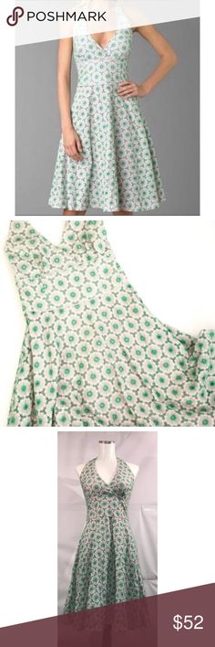 Lilly Pulitzer Sz 4 Floral Eyelet Halter Dress EUC Lilly Pulitzer Sz 4 Pink and Green Floral Eyelet Halter Tea Dress🔸Size 4🔸Pink and green Floral eyelet🔸 Halter top🔸V Neck🔸Fitted midsection🔸Flared lined bottom🔸Knee length🔸Bust 32-34🔸Cotton-no stretch🔸Back zip with eye hook closure🔸Pre owned great condition! No rips/stains or holes! Lilly Pulitzer Dresses Midi