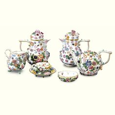 A Meissen part tea service late 19th Century encrusted with colourful flowers, and painted with insects, comprising a teapot and cover, two hot milk jugs and covers, a cream jug and a similarly decorated miniature cup and saucer Quantity: 9