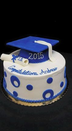 Cookie Jar Bakeshop I Custom Cakes I Blue & White Graduation Cake I Graduation Cake with Cap & Tassel