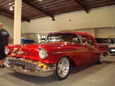 1957 Oldsmobile clean lines with a big mouth. WOW That Statement fits a lot of Women I Know.!!!!