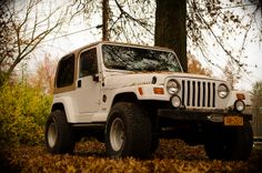 Jeep Wrangler   Flickr - CharlieSturm 1998 Sahara Jeep Wrangler White and tan, hardtop. Fall.
