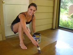 "This is a surprisingly easy task, so anyone with a garage, sunroom, basement or porch with a concrete floor should seriously consider this super simple process. We used Behr Semi-Transparent Concrete Stain in ""Tuscan Gold"" from Home Depot to give our sunroom's unfinished looking concrete floors a warm wash of honey-gold color:"