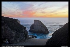 Offshore rock at sunset, Davenport. SF Bay area, California, USA