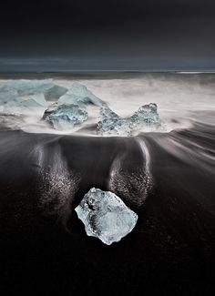Ice left by the surf on a black sand beach in Iceland. Landscape photography by Samuel Feron.