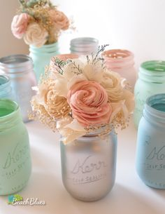 Silver and pastel mason jars for weddings by BeachBlues and bouqets by CurousFloral on Etsy.