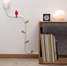A great way to hide cords in a kids room.  I have a moon light to hang up in my sons room and the cord is white...blah....now I have some ideas on how to integrate it in.