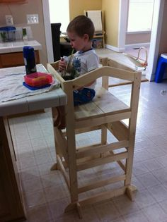 I like the addition of a seat to this helper's work tower. Kids could eat snacks at the counter bar area while I'm working in the kitchen.