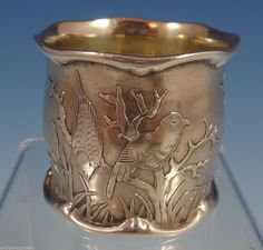 American sterling silver acid-etched napkin ring with design of birds and branches, (antiquecupboard)(a) Napkin Ring Folding, Metal Jewelry, Vintage Jewelry, Silver Napkin Rings, Aesthetic Movement, Bird Design, Timeless Elegance, Precious Metals, Antique Silver