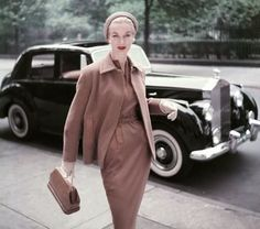 Supermodel and fashion icon Sunny Harnett poses with black Rolls for Vogue Magazine, 1953.